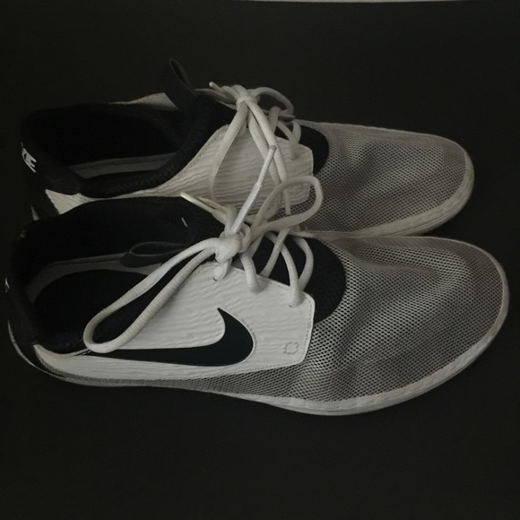 new product b0083 3286d Nike Men s Solarsoft Moccasin Black   White Shoes.  M 5ad4fb86b7f72bc3454f96a8